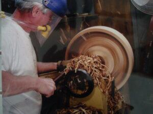 Jim turning bowl at the lathe